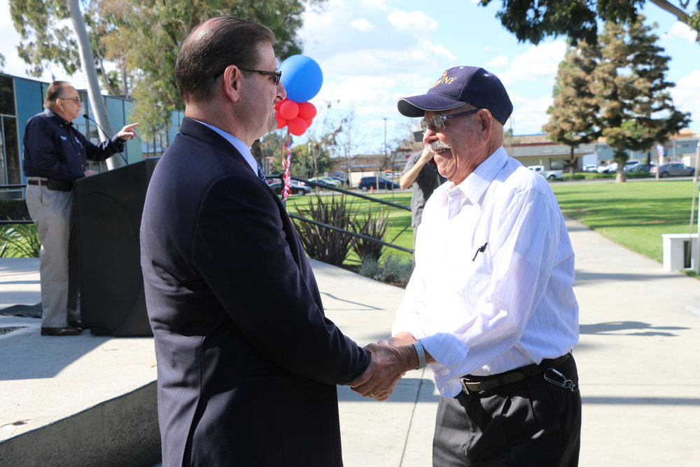 A veteran greets Norwalk's new city manager, Jesus Gomez. Photo courtesy city of Norwalk