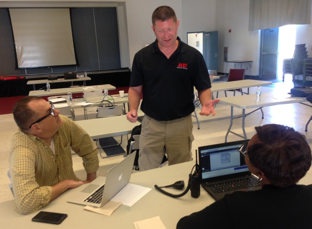 During a break in the classroom training, ALICE instructor Eric Spicer (center), reviews lesson details with Garry Creel of the Azusa Unified School District and Elaine Williams of the Norwalk-La Mirada Unified School District