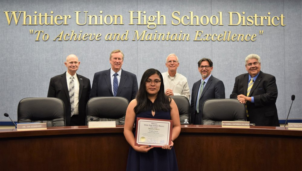 California High School senior Avigahy Garcia was honored with an Award of Merit by the Whittier Union Board of Trustees on Sept. 11 for overcoming challenges in her language development to become a straight-A student on the road to college. Pictured are Garcia along with the Board of Trustees, Tim Schneider, Leighton Anderson, Jeff Baird, Vice President Dr. Russell Castañeda-Calleros and President Dr. Ralph Pacheco.