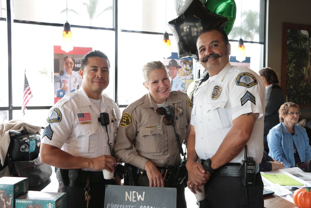 Norwalk public safety officers and a sheriff's deputy at a Coffee with a Cop event last year. Photo courtesy city of Norwalk