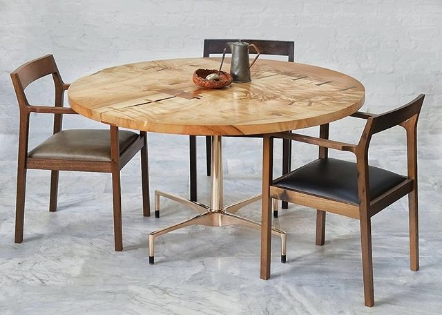 Trasda dining table with book-matched Scottish Sycamore top and solid Bronze base. Surrounded by three of our Chaoran armchairs shown here in Black Walnut and oxidised Elm.#furniture #furnituredesign #diningtable #interiors #interiordesign #decor #bespokefurniture #armchair #crafts #craftsmanship #handmade #wood #woodworking #design #sculpture #bronze #metalworking #madeinscotland