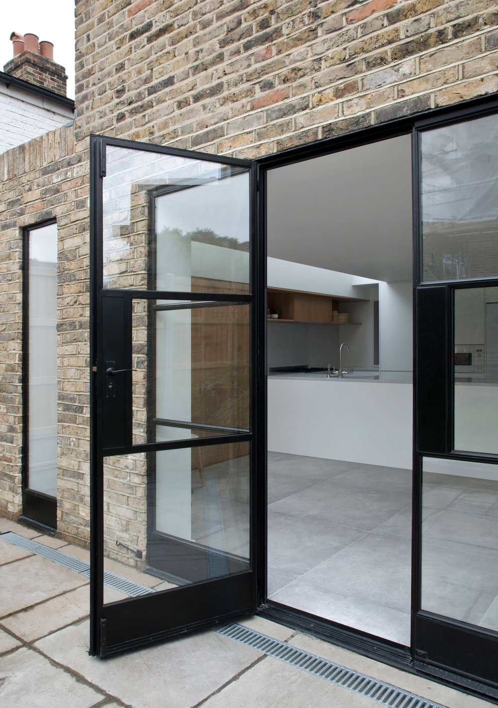 MOCT-STUDIO---External-view-through-opening-towards-kitchen.jpg