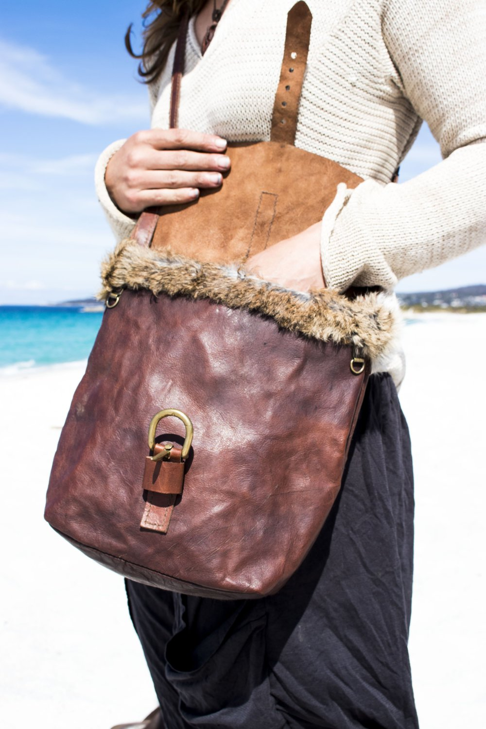 Picture: Using the kangaroo leather that Josh produces at his Tannery in the Yarra Valley (where this workshop will be held), Kirsty Button commissioned Josh to produce this bag with her. *Fur is roadkill rabbit.