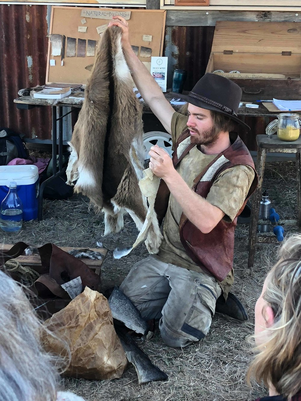Pictured: Josh (your friendly facilitator), holding up the fish skins that were tanned by previous students and discussing how methods used on fish are transferred to larger skins such as the goat fur skin he is holding.