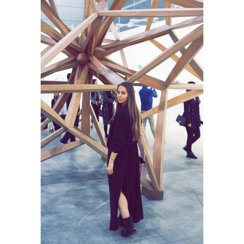 Maria Korolevskaya in front of  Wooden Star I  by Frank Stella at Marianne Boesky Gallery (New York), Art Basel Hong Kong