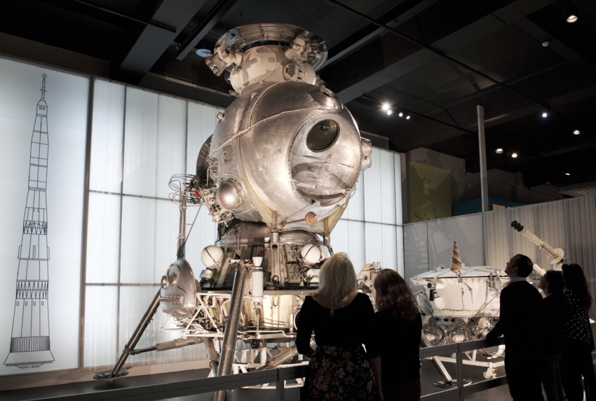 Visitors with the LK-3 lunar lander in the Cosmonauts exhibition