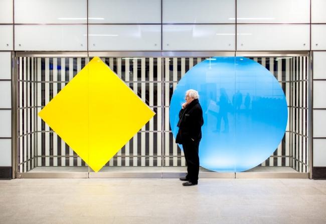 Daniel Buren with his installation at the Tottenham Court Road tube station. Photo by Benedict Johnson.