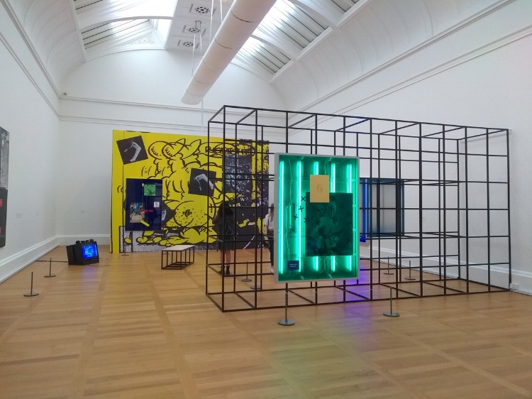 Installation view of Simeon Barclay's current exhibition 'The Hero Wears Clay Shoes' at Tate Britain.