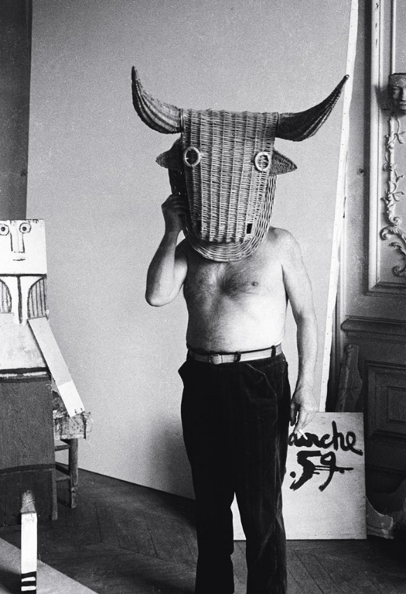 Picasso wearing a bull's head intended for bullfighter's training, La Californie, Cannes, 1959. Photo by Edward Quinn ©