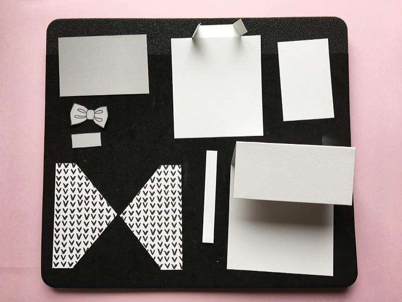 Du har nu: 4 hvide dele (base, skjorte, bund og aflang firkant til skjorte) 3 grå dele (bund, butterfly og firkant til lomme) 2 dele til vest