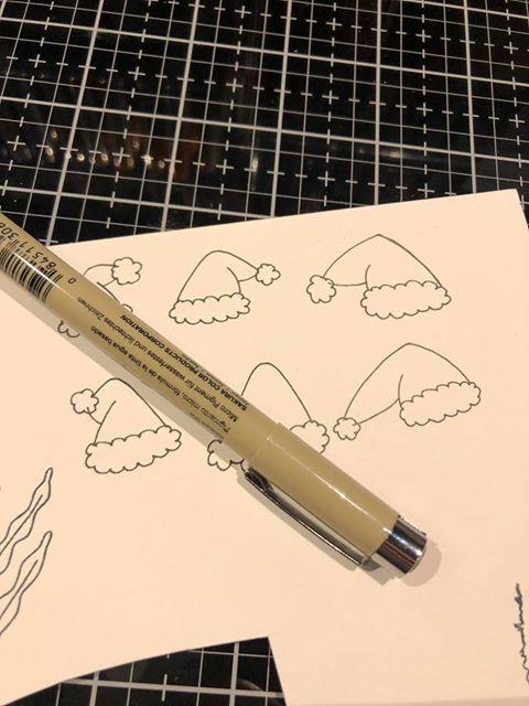 Tegn selv din nissehue med en sort    Micron pen