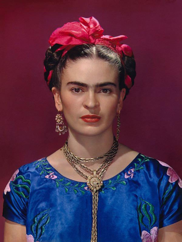 Frida Kahlo in blue satin blouse 1939, photograph by Nickolas Muray.©Nickolas Muray Photo Archives