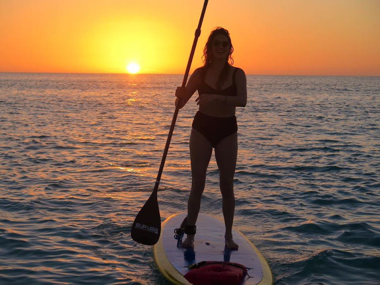Sunset SUP paddleboard yoga on Bradenton Beach