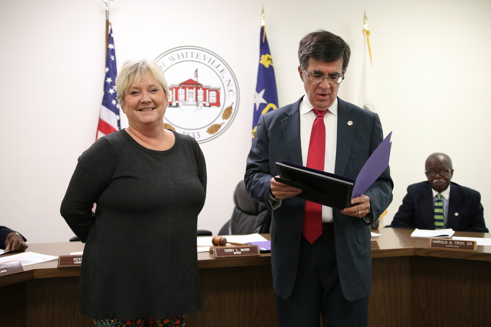 Mayor Terry Mann thanks Vicki Pait for her service on city council