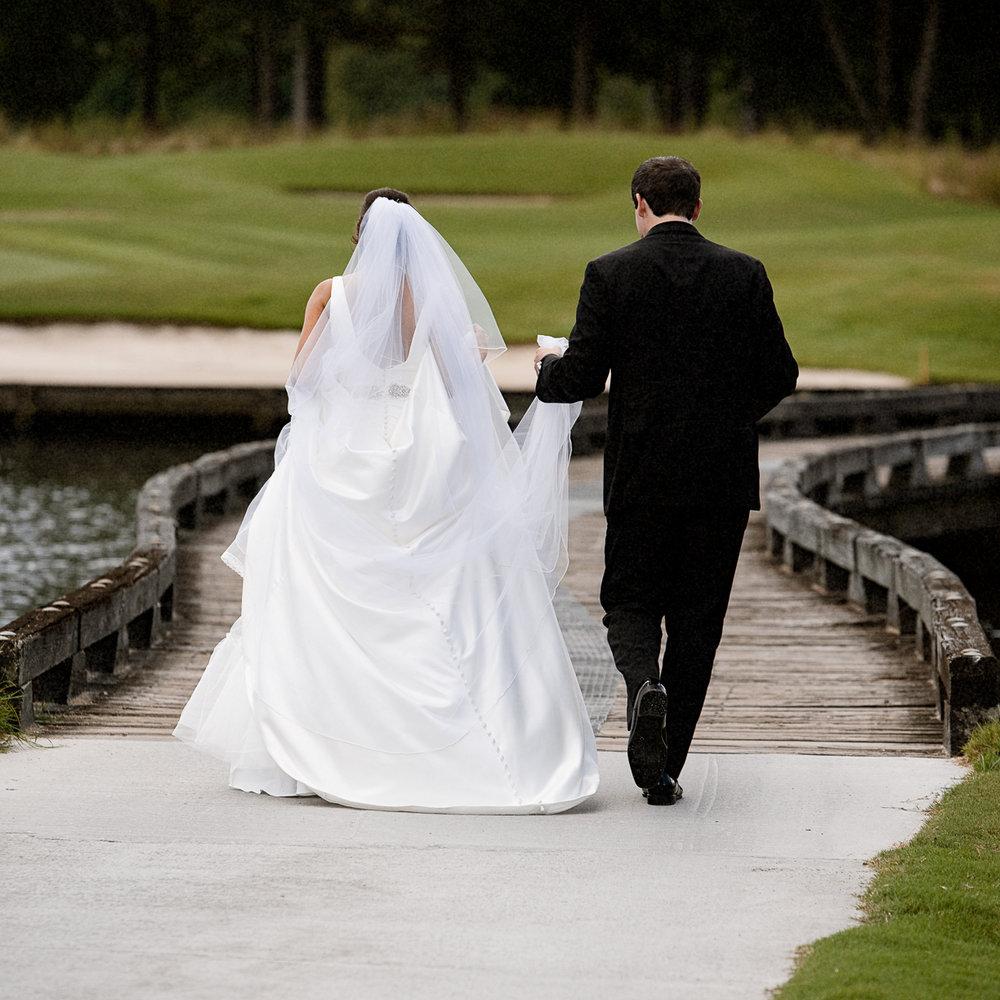 Groom helping his bride