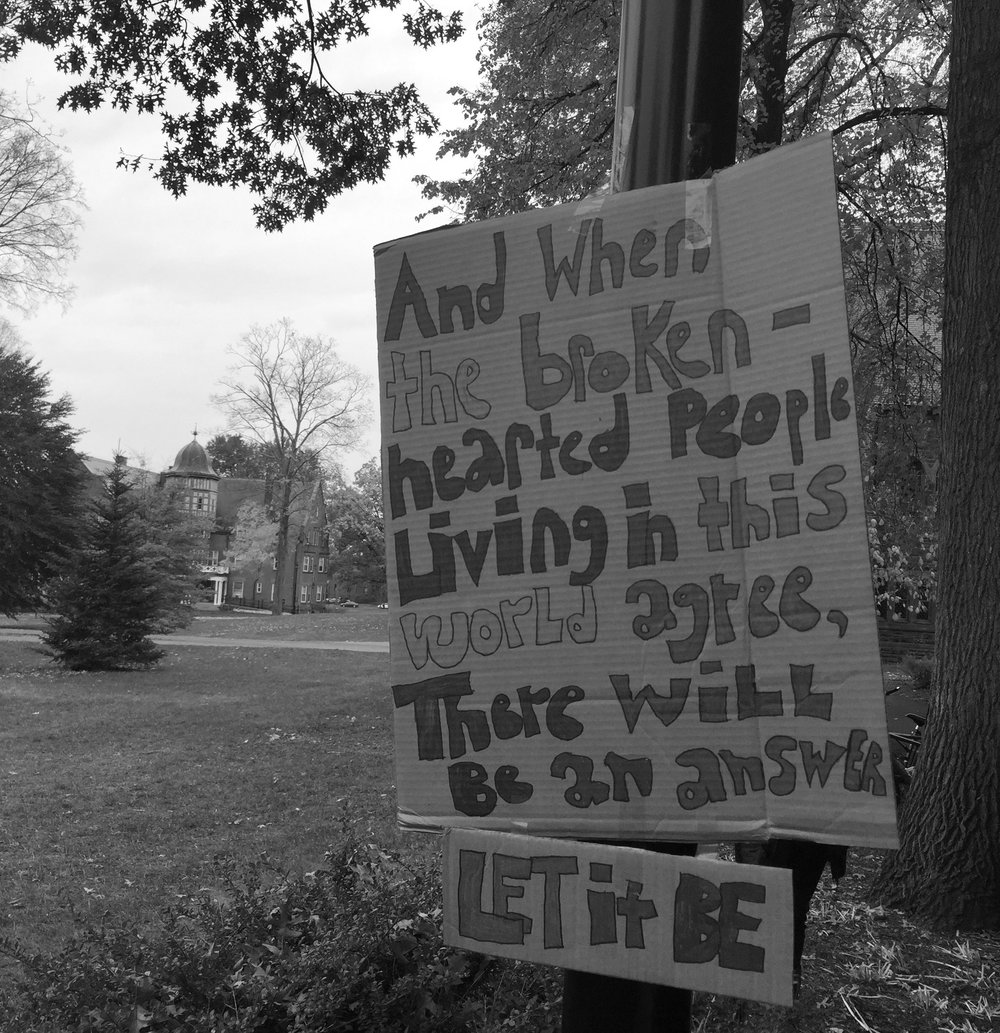 Photo by Hannah Roach '17 This sign, amongst others were taped up outside the library and around campus in protest of the election.