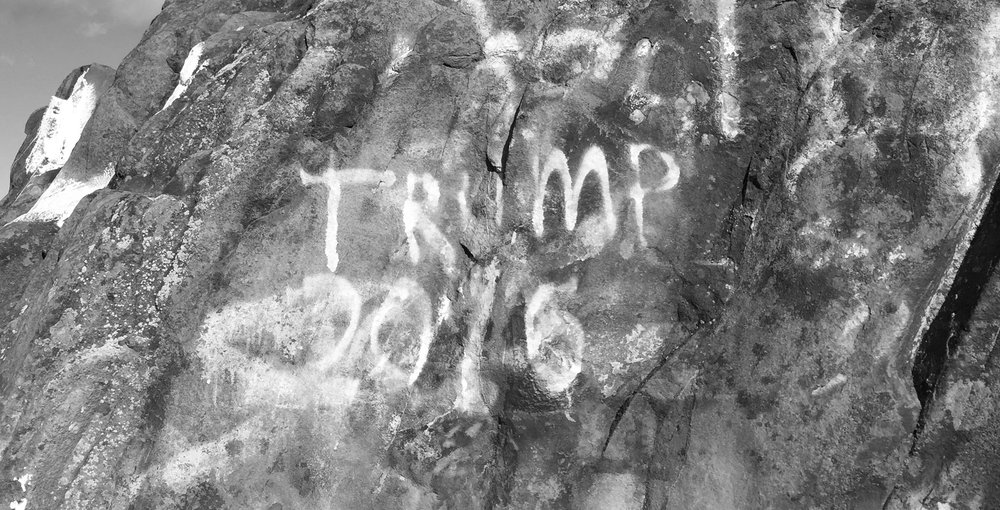 Top right photo by Michael Poole. All others by Hannah Roach '17 Volunteers gather to erase the hateful words written on the summit of Mount Tom in Easthampton on Friday.