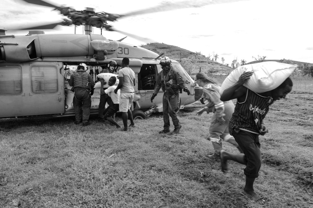 Photo courtesy of Wikimedia Commons Marines and sailors offered aid in the form of food to the Haitian city Jabouin following the wreckage of Matthew.