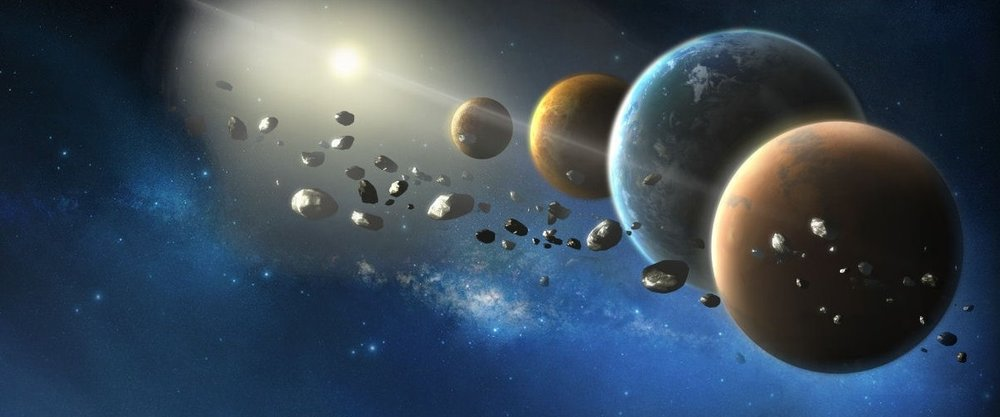 Photo courtesy of Wikimedia Commons Used as a backdrop for information about the NASA Discovery Programs, this artwork shows a rendering of planets and asteroids similar to those that Lucy and Psyche, two new NASA exploratory space missions, will explore.