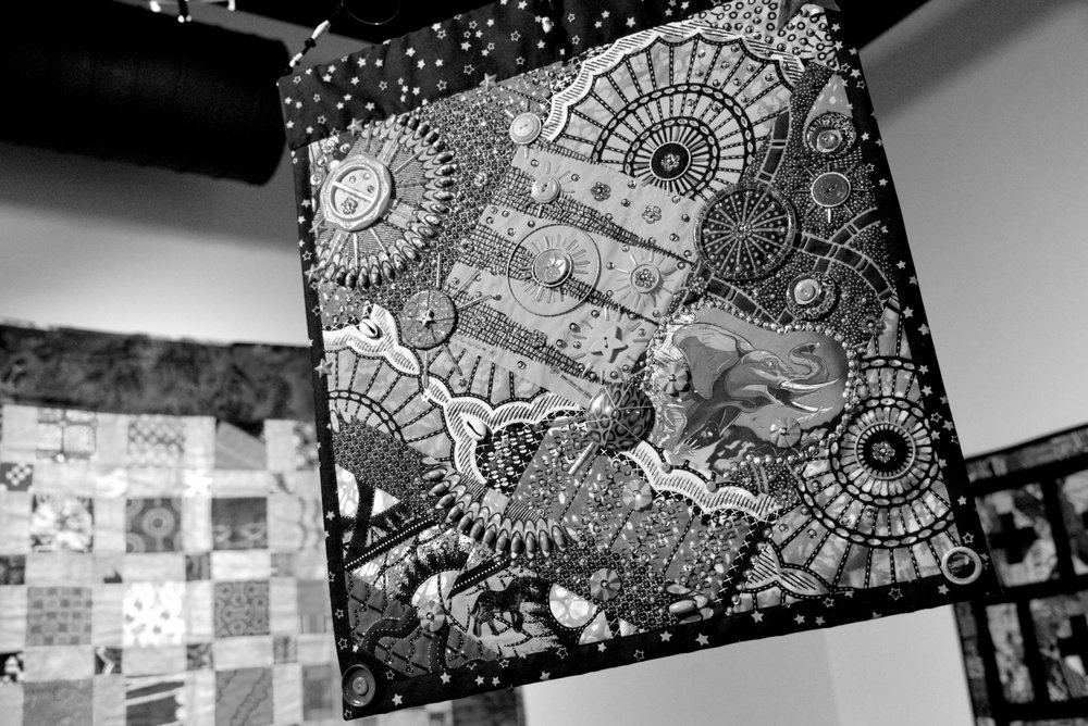 Photo by Amber Haraguchi '20 Quilt from Sisters in Stiches Joined By The Cloth Inc. hangs as part of APAU's Freedom Day Gallery.