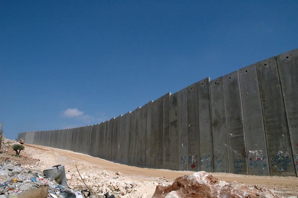Photo courtesy of Wikimedia Commons The Israeli West Bank barrier is a 10 meter tall wall stretching along 5 percent of the West Bank, where Israel is planning to create a new settlement.