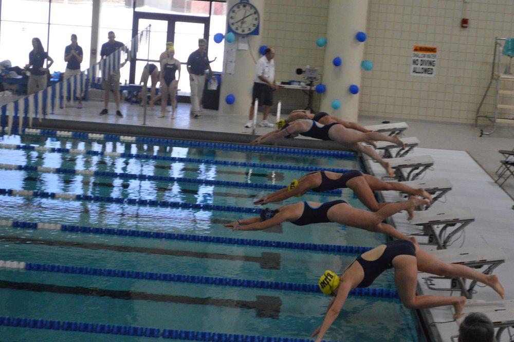 Photo by Faryal Mirza '20 Monika Sharma '19 and Emily Craig '17 swim the 100 free against three Smith swimmers on Saturday.