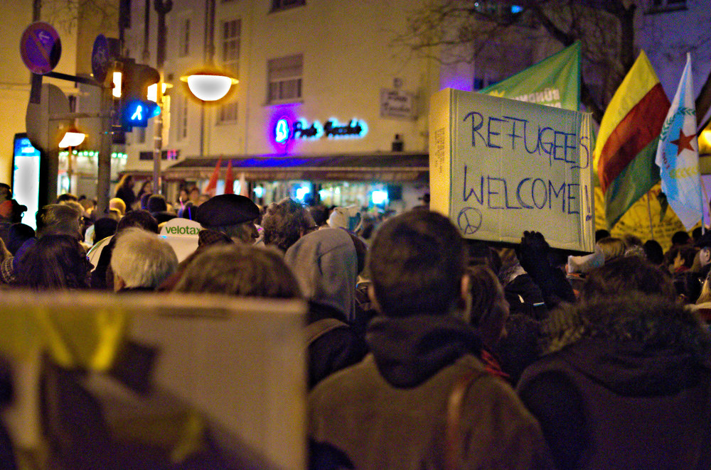 Photo courtesy of Creative Commons In 2015, Germans protested to demonstrate support for refugees, who will have a more difficult time immigrating to Germany under the new plan.