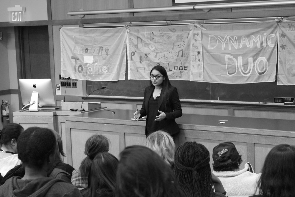 Photo by Megan MacQuerrie '19 Speaker Charu Sharma '14 addresses room of young computer scientists at the Girls in Tech Conference.