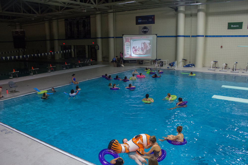 "Photo by Izzy Olgaard '18  Students attending Residential Life's Dive in Movie watch ""Teen Beach Movie"" in floaties in the Kendall Natatorium."