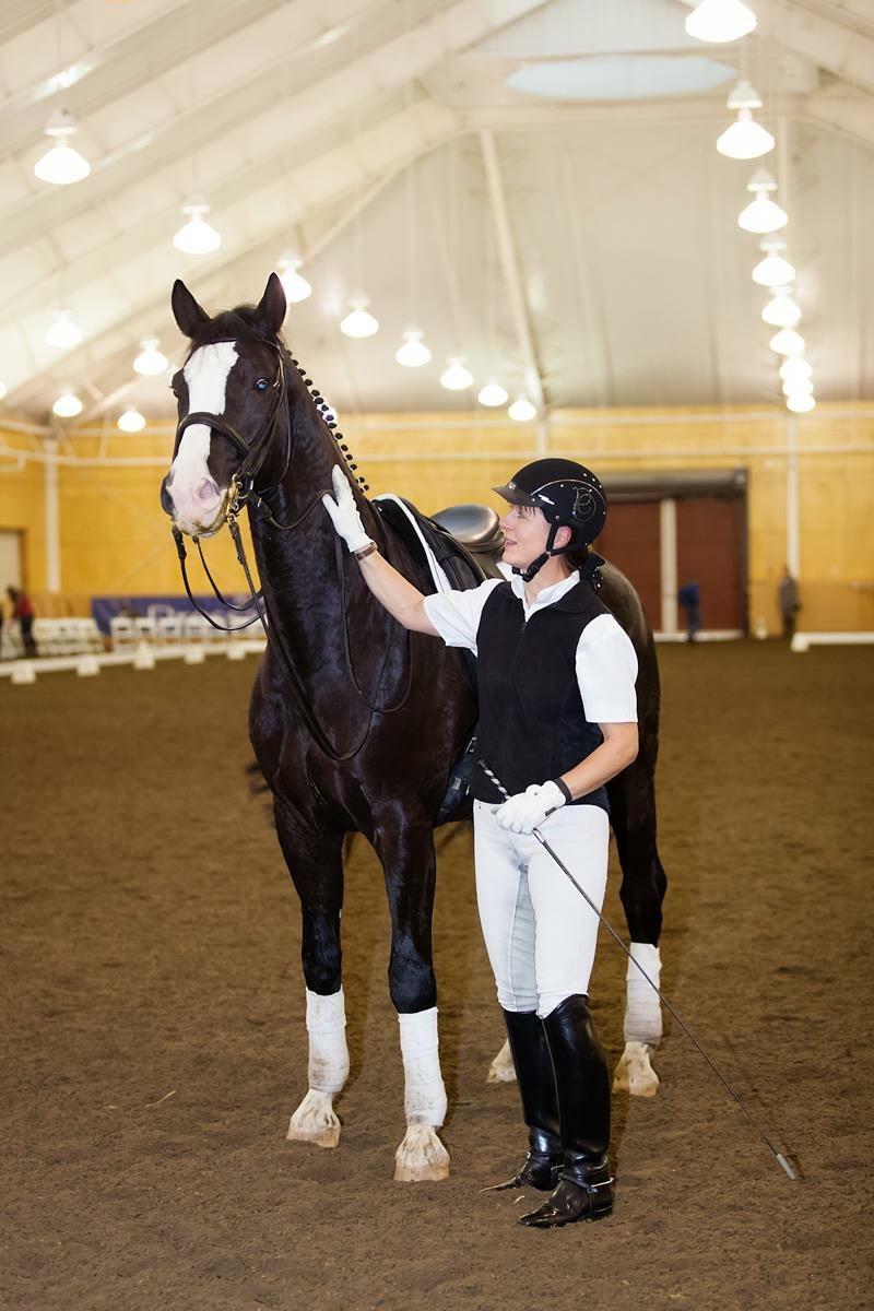 hoto courtesy of Jutta Lee Mount Holyoke dressage coach Jutta Lee caresses horse