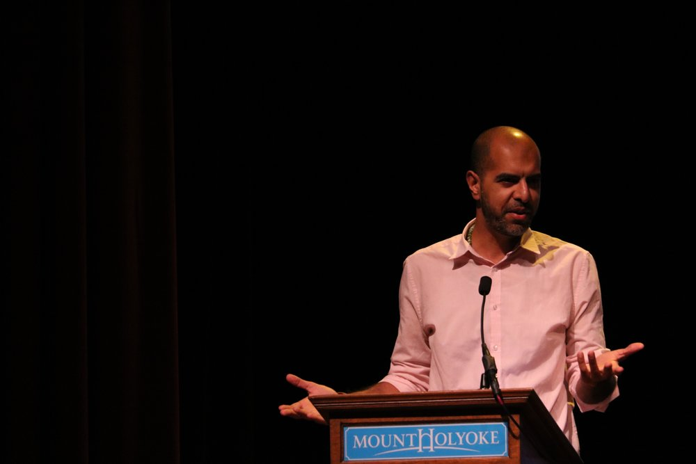 Photo by Dana Pan '20 Haroon Moghol speaks on the Muslim-American experience in the Chapin Auditorium at Mount Holyoke College.