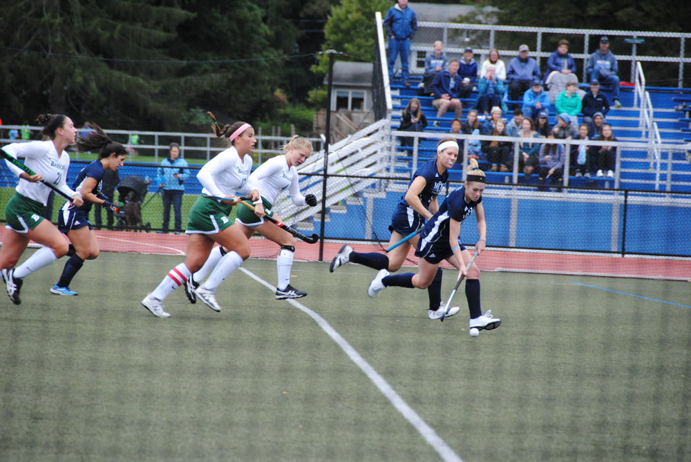 Photo by Ayla Safran '18 Sophomore Ana Ballou '20 runs down the field, controlling the ball, as members of the Babson College team trails behind her.  Seniors Katie Braz '19 and Sophie Perekslis '19,  trying to catch up with her as they tried to score.