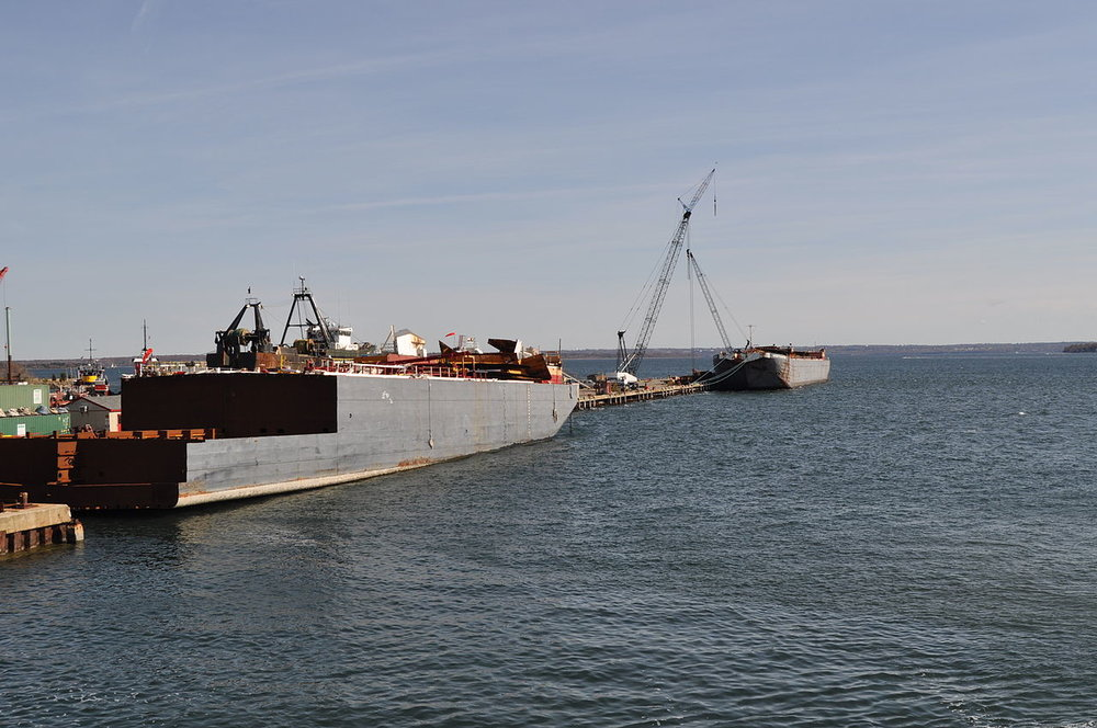 Photo courtesy of Wikimedia Commons   Narragansett Bay, pictured with barges, is the largest estuary in New England and major source of seafood.