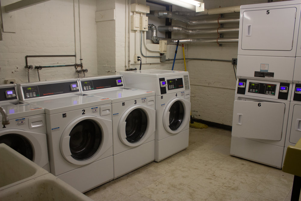 Photo by Izzy Olgaard '18  The new washing machines and dryers, depicted in the basement of Pearsons Hall, have caused many problems.
