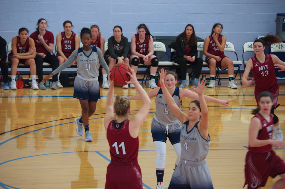Photo by Casey Pan '18  With the Lyons on defense, guard Ireland Kennedy '21 picks up ball and plays defense on MIT's Maude Gull.