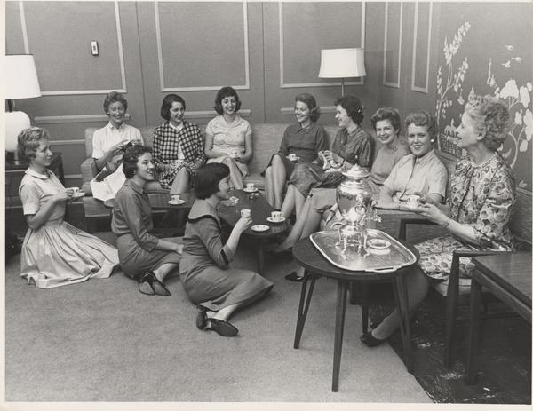 Photos courtesy of Archives and Special Collections  Students wear dresses and skirts to enjoy after-dinner coffee in the lounge of Buckland residence hall in 1960.
