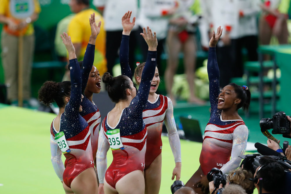 Photo courtesy of Flickr  USA Olympic gymnasts Simone Biles, Gabby Douglas, Laurie Hernandez, Madison Kocian and Aly Raisman celebrate at the 2016 Summer Olympics. Biles, Douglas and Raisman have accused Nassar of sexual assault.
