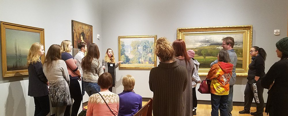 """Photo by Jenny Cho '20  Student guide Serena McDonald-Newman '20 shows """"A Country Town"""" by Daniel Garber during the Art Museum's first Sightlines Tour of the semester."""