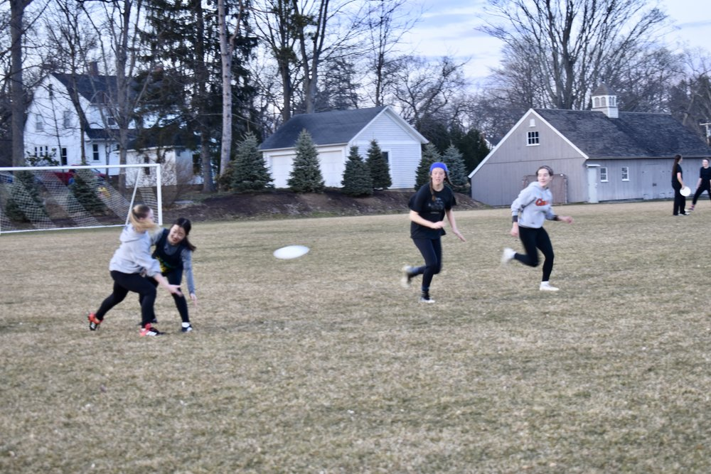 Photo by Emma Himmelberger '20  The Mount Holyoke ultimate team practices on an afternoon in April. They hope to make Nationals this season.