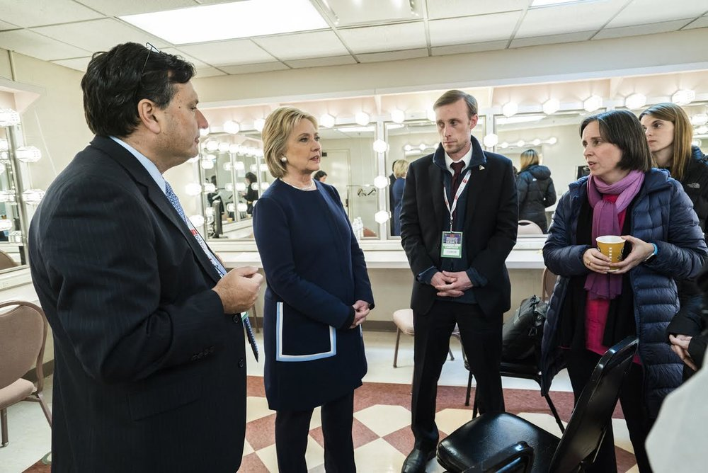 Photo courtesy of Barbara Kinney  Ron Klain, Hillary Clinton, Jake Sullivan, Ann O'Leary '93 and Sara Solow meet after the primary democratic debate in Flint, MI on March 6, 2016.