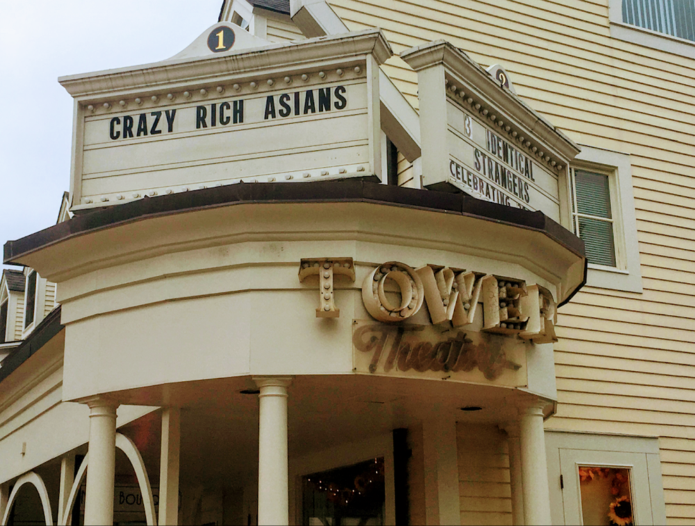 "Photo by Kate Turner '21  Tower Theaters in South Hadley displays ""Crazy Rich Asians"" on the sign, enticing movie-goers to the blockbuster."
