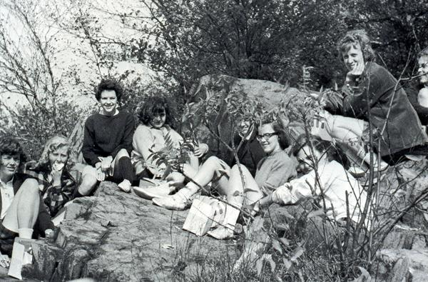 Photo courtesy of MHC Archives and Special Collections   A group of Mount Holyoke students enjoy a picnic together, possibly at the top of Skinner Mountain on Mountain Day in fall semester 1965.