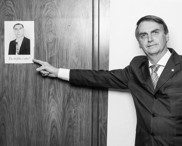 Photo courtesy of Flickr   Bolsonaro points to picture of Brazilian dictator in support of his regime.