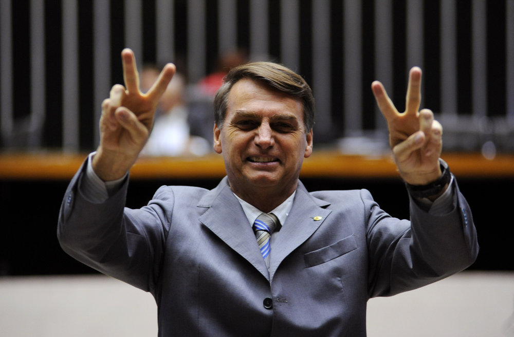 Photo courtesy of Wikicommons   Jair Bolsonaro flashes peace signs after election win.