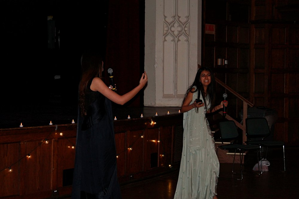 Photo by Grace Mercer '22   Rushna Sukhera '20 and Amal Fadoo '20 host AWAZ's Diwali event.