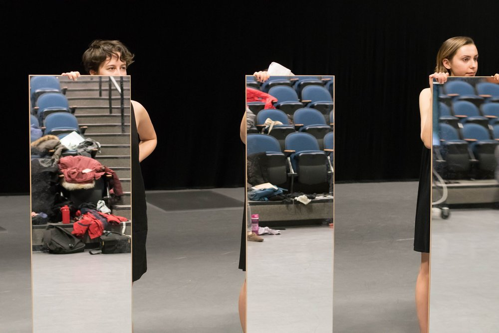 """Photo courtesy of Charles Flachs  Cara Board '19 and Angelina Schenck '19 at an early rehearsal of """"Mirror Piece."""""""