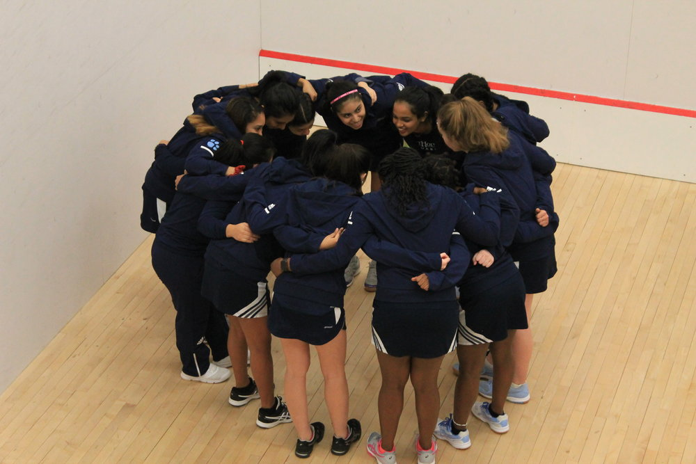 Photo by Grace Mercer '22 The Mount Holyoke Squash Team huddles together to celebrate their victory at the Seven Sisters Championship on Saturday, Feb. 9.