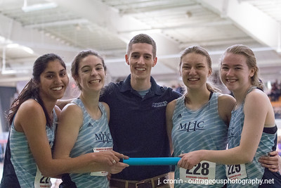 Photo by J. Cronin Outrageous Photography From left to right: Simone Jacob '21, Emsie Cronin '19, Head Coach Christopher Kibler, Corrin Moss '19 and Sydney Nash '22 celebrate after the Div-III New England Championships at Bowdoin College.