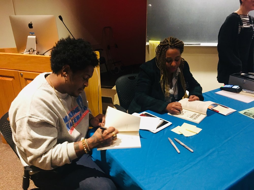 Photo by Caroline Mao '22   Danez Smith (left) and Morgan Parker (right) sign their books after their talk.