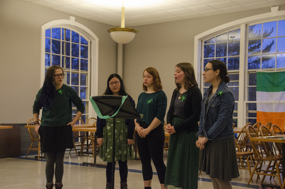 Photo by Margaret Skelly '21 The board members of Folk Music and Dance Society led the audience in a traditional Irish song at the second annual Irish Fest night.